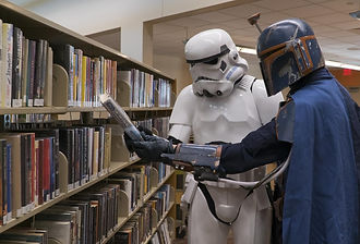 Storm Trooper and Boba Fett checking out library books