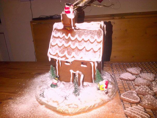 The gingerbread house looks great with a little icing for snow effect!