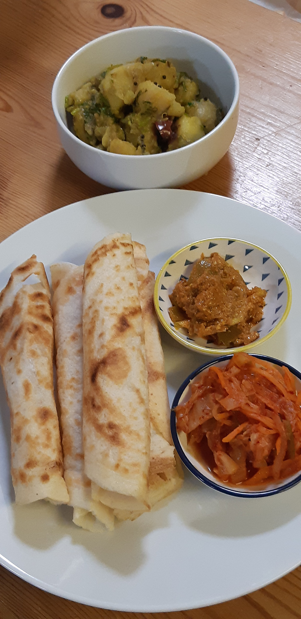 Dosa served with kimchi, lime pickle and Potato Masala