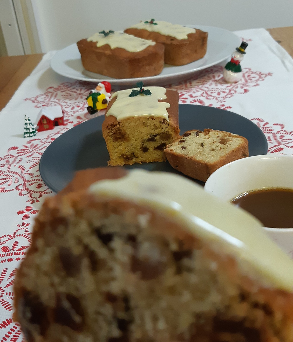 Hand holding a slice of gluten free Christmas cake
