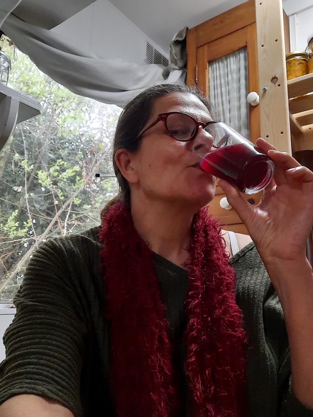 Woman drinking purple carrot kanji