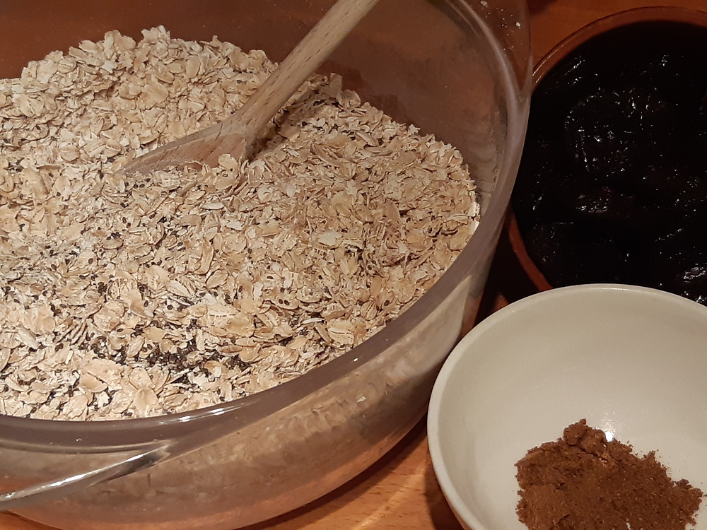 Oats in a bowl with chia seeds, garam masala and Agen prunes
