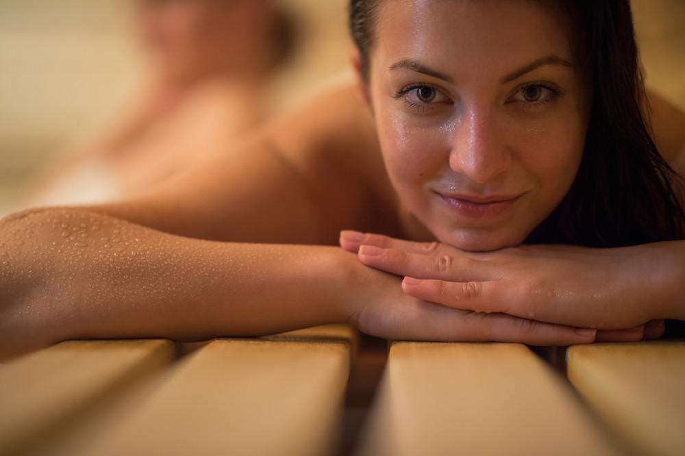 Sweating woman in sauna