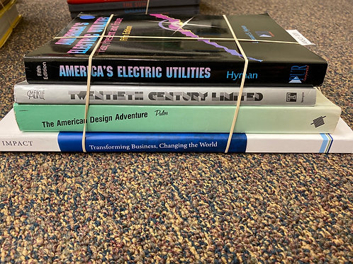 Variety of books on electric utilities, design, and business.