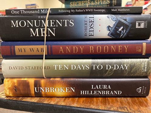 Variety of World War II books, Monuments Men, Unbroken, D-Day, Rooney