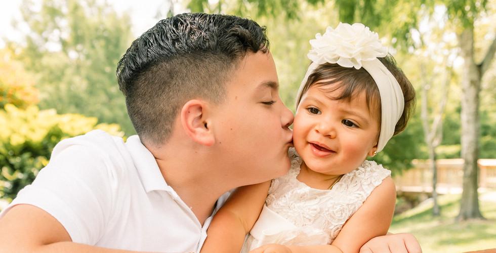 Siblings kiss