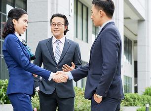 medium-shot-business-people-shaking-hand