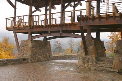 stone and wood deck bridge nw artisan architecture