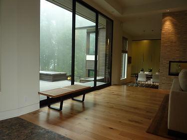 living room modern spacious floor plan with wood floors