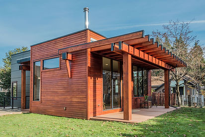 Front view of sustainabilty built wood and glass home.