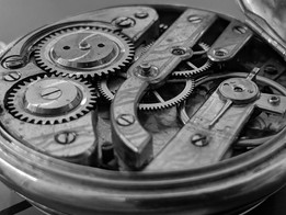 open-timepiece-exposing-cogs-and-gear-wh