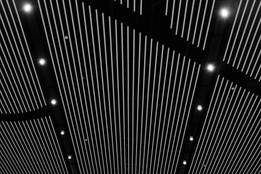 white-vertical-lines-on-a-black-ceiling.