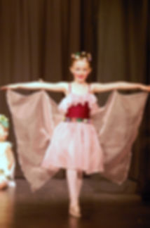 A young ballet dancer is a flower fairy in the popular dance show. Take children's ballet class in Caterham.