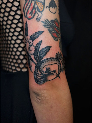 Black and grey delicate arm tattoo