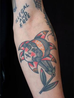 Girl head in flower design tattoo custom