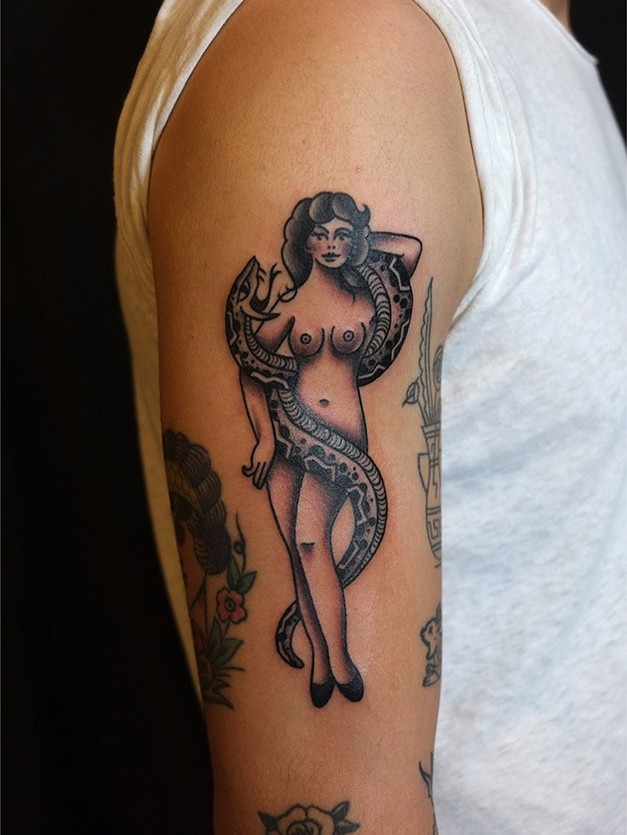 Snaked and Snake Charmer Tattoo