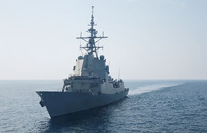 A war frigate ship sailing at sea in sum