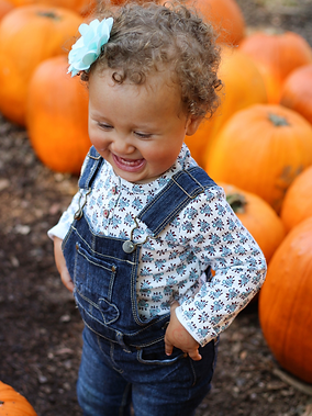 Baby in a pumpkin patch.png