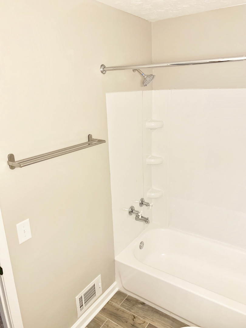 Brand New Tubs, Vanities, Toilets, & Ceramic Tile Floors In All Bathrooms!