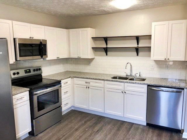 Kitchen Featuring All New Stainless Appliances