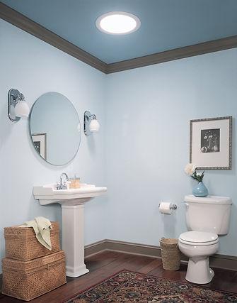 Sun Tunnel skylight in blue bathroom.jpg