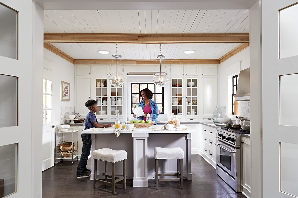 Sun Tunnels brightening a pretty kitchen while a mother and son spend time together.
