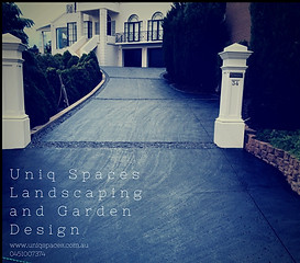 concrete driveway and landscaping