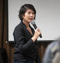 beautiful asian woman speaking over participants_edited.jpg