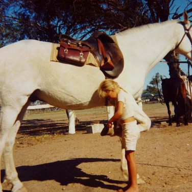 Looking after her lovely horse back in aussi