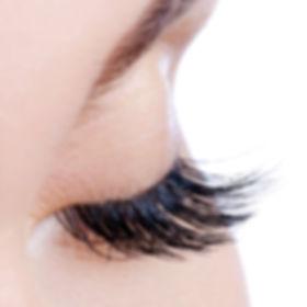 Macro shot of a female eye with long fal