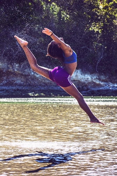 Women Jumping on water as doing exercise