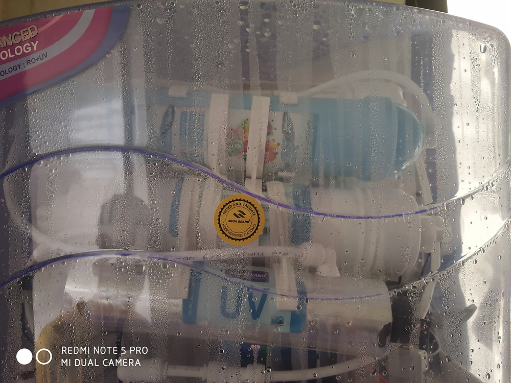 water droplets can be seen on cabinet of RO purifier which shows that it is leaking
