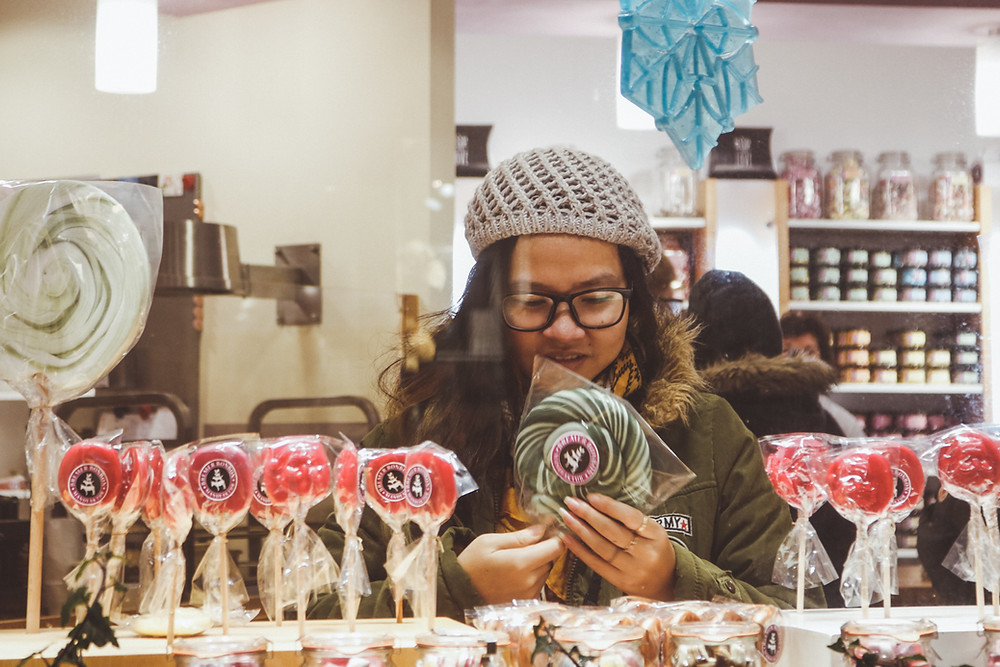 girl in candy shop lollipop christmas germany