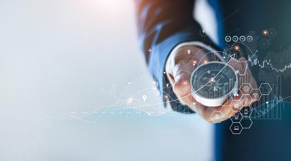 Businessman holding a navigation compass