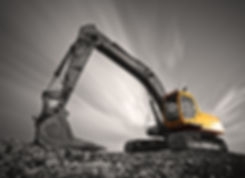 Excavator parked on stone ground against