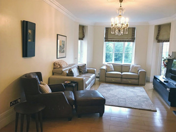 Living room - room re-painted, new furniture, new soft furnishings, chandelier and accessories