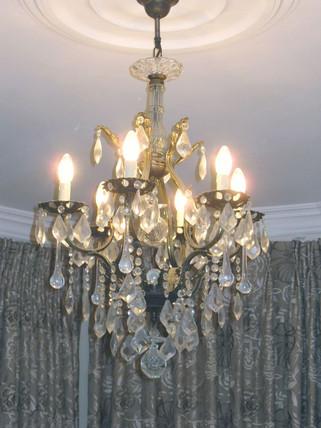 Master bedroom antique crystal chandelier