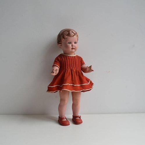 Antieke pop met stempel van Schildkröt (T40) met origineel kleedje