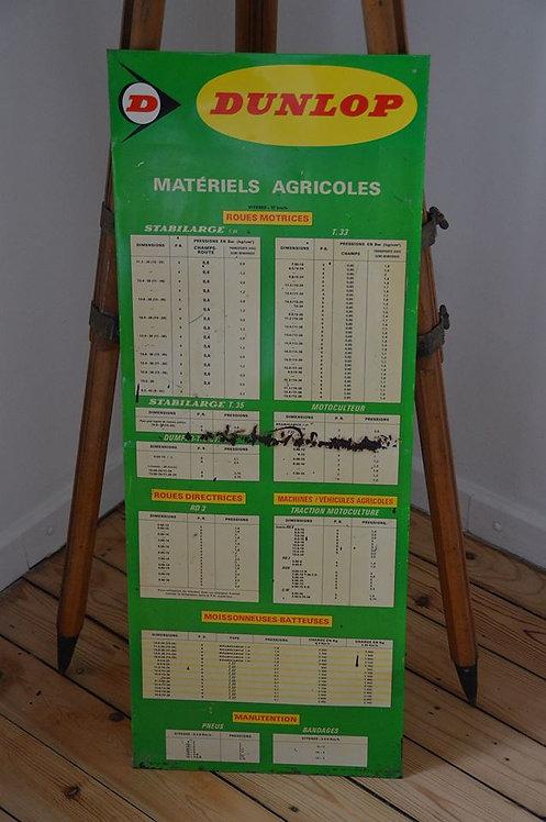 Oud Franstalig reclamebord van Dunlop met bandenspanningstabel voor tractoren