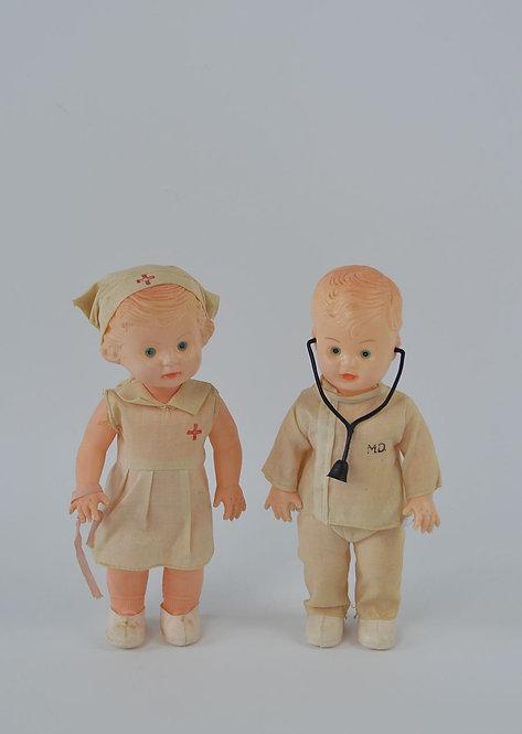 Antieke poppen van dokter en verpleegster in celluloid, jaren 50