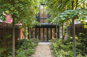 Brooklyn Heights townhouse exterior with black framed french doors and greenery.
