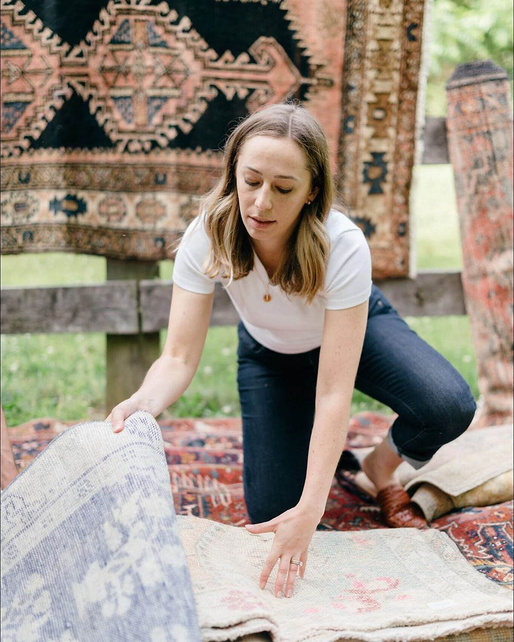 Washington, Vintage rug company owner looks at her new collection.