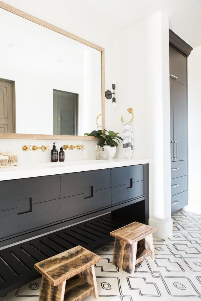 Bathroom+with+patterned+tile,+white+countertops+and+gold+hardware