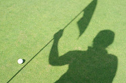 Golfer shadow hold flag on green golf.jp