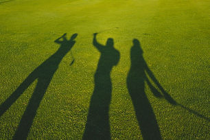 Three golfers with open hands silhouette
