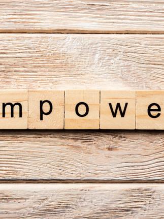 empower word written on wood block. empo