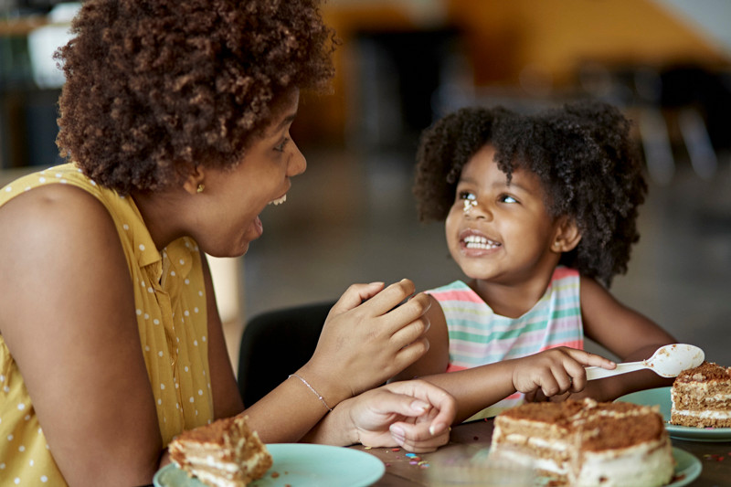 Afro-Caribbean mother and daughter at home