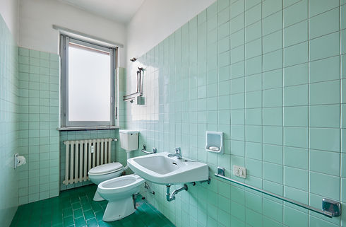 old-bathroom-interior-with-green-tiles-P