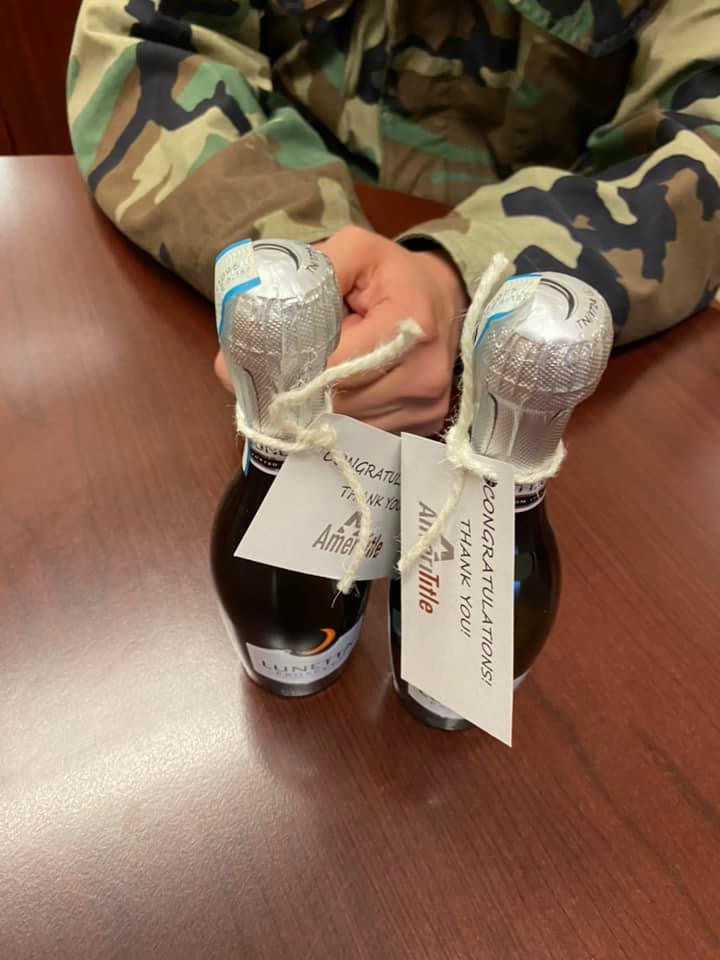 Veteran appreciates some giftex Champagne after signing the closing docs on his new Prineville home with 2 acres and water rights.