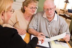 older-couple-looking-at-paperwork.jpg